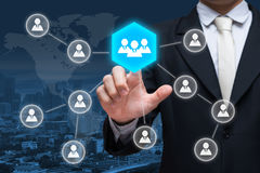 Biznesmen ręki dotyka biznesmena ikony sieć - HR, HRM, MLM, te Zdjęcie Stock