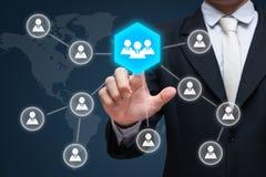 Biznesmen ręki dotyka biznesmena ikony sieć - HR, HRM, MLM, te Zdjęcie Royalty Free