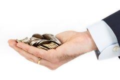 Biznesmen ręka trzyma stos euro monety Fotografia Stock