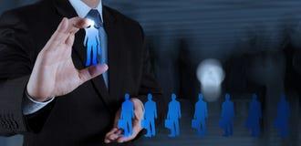 Biznesmen ręka wybiera ludzi ikon Zdjęcia Stock
