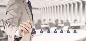 Biznesmen ręka wybiera ludzi ikon Fotografia Stock