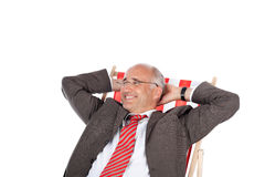 Biznesmen relaksuje w biurka krześle Fotografia Royalty Free