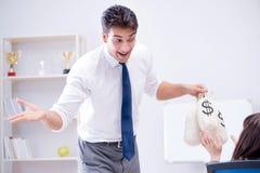 Biznesmen robi prezentaci z pieniędzy workami Obrazy Stock