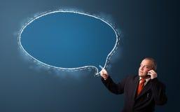 Biznesmen robi rozmowie telefonicza i przedstawia mowa bąbla kopię Zdjęcie Stock