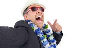 Biznesmen robi selfie POV Jest ubranym kostium, Hawajski neckl obrazy stock
