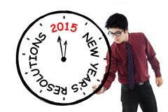 Biznesmen robi zegarowi dla jego postanowienie czasu Fotografia Stock