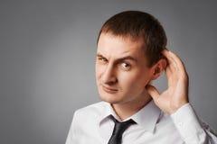 Biznesmen słucha obraz stock