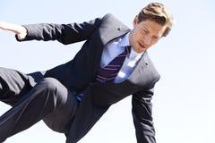 Biznesmen skacze nad coś Zdjęcia Stock