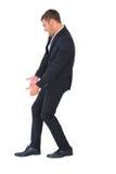 Biznesmen skrzywiony z ręka puszkiem Obraz Stock