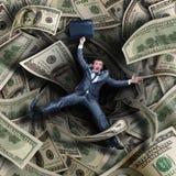 Biznesmen spada w pieniężnego tunel Obrazy Royalty Free