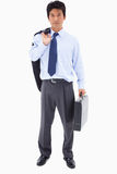 Biznesmen target759_1_ teczkę i jego kurtki ove Obrazy Royalty Free