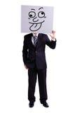 Biznesmen trzyma śmiesznego wyrażeniowego billboard fotografia stock