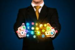 Biznesmen trzyma app ikony chmurę Obrazy Royalty Free