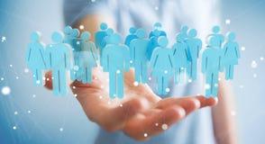 Biznesmen trzyma 3D odpłaca się grupy ludzi w jego ręce Fotografia Royalty Free