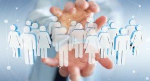 Biznesmen trzyma 3D odpłaca się grupy ludzi w jego ręce Obrazy Stock