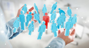 Biznesmen trzyma 3D odpłaca się grupy ludzi w jego ręce Obraz Royalty Free