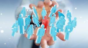 Biznesmen trzyma 3D odpłaca się grupy ludzi w jego ręce Zdjęcie Royalty Free