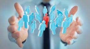 Biznesmen trzyma 3D odpłaca się grupy ludzi w jego ręce Obraz Stock