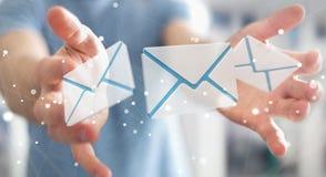 Biznesmen trzyma 3D renderingu emaila latającą ikonę w jego ręce Zdjęcie Stock
