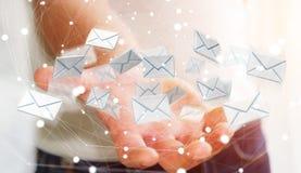 Biznesmen trzyma 3D renderingu emaila latającą ikonę w jego ręce Obraz Royalty Free