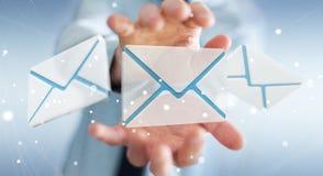 Biznesmen trzyma 3D renderingu emaila latającą ikonę w jego ręce Obrazy Royalty Free