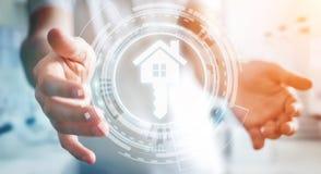 Biznesmen trzyma 3D renderingu ikony dom w jego ręce Fotografia Royalty Free