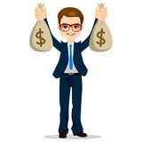 Biznesmen Trzyma Dolarowe pieniądze torby Zdjęcia Royalty Free