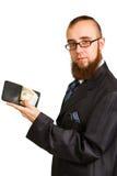 Biznesmen trzyma dolary w szkłach Zdjęcie Royalty Free