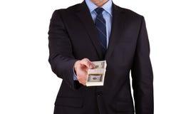 Biznesmen trzyma dużą sumę gotówka Fotografia Stock