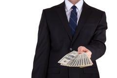 Biznesmen trzyma dużą sumę gotówka Obraz Royalty Free