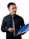 Biznesmen trzyma falcówkę odizolowywającymi na bielu opowiadać i zdjęcie stock