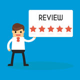 Biznesmen trzyma 5 gwiazd przeglądowego znaka sukces i misja fla Obraz Royalty Free