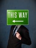 Biznesmen trzyma kierunku znaka Fotografia Royalty Free