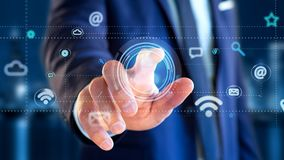 Biznesmen trzyma kontakt ikony otaczanie app i socjalny obraz stock
