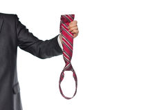 Biznesmen trzyma pasiastego krawat Zdjęcie Royalty Free