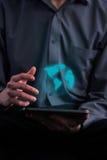 Biznesmen trzyma pastylkę komputerowa Obraz Royalty Free