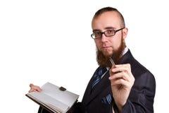 Biznesmen trzyma pióro prosi podpis na dokumencie zdjęcie stock