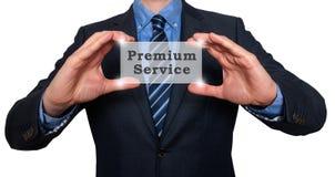 Biznesmen trzyma premii usługa w jego rękach Fotografia Royalty Free
