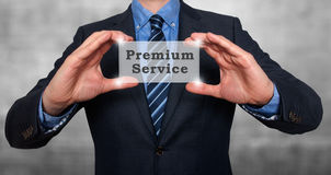 Biznesmen trzyma premii usługa w jego rękach Zdjęcia Royalty Free