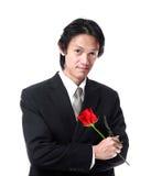 Biznesmen trzyma róży, atrakcyjny azjatykci mężczyzna na białym backgro Zdjęcia Royalty Free