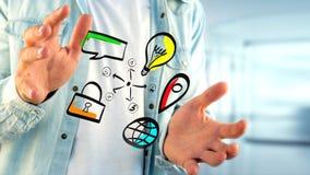Biznesmen trzyma ręka rysującą ikonę biznes, multimedia Zdjęcia Stock