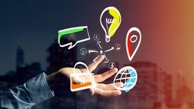 Biznesmen trzyma ręka rysującą ikonę biznes, multimedia Obrazy Stock