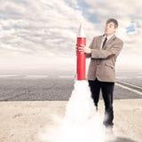 Biznesmen trzyma rakietę Obraz Stock