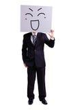Biznesmen trzyma szczęśliwego wyrażeniowego billboard obraz stock