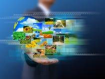 Biznesmen trzyma zieloną ziemię w rękach Zdjęcia Stock