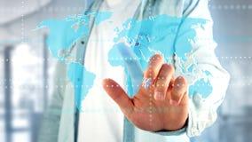 Biznesmen trzyma Związaną światową mapę na futurystycznym interf Fotografia Stock