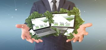 Biznesmen trzymający Związanych przyrząda otacza liśćmi 3d obrazy royalty free
