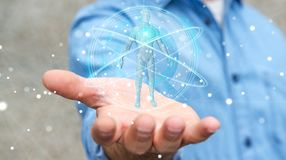 Biznesmen używa cyfrowego promieniowania rentgenowskiego ciała ludzkiego obrazu cyfrowego interfejs 3D ren Zdjęcia Stock