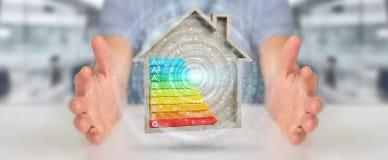 Biznesmen używa 3D renderingu oceny energetyczną mapę w drewnianym h royalty ilustracja