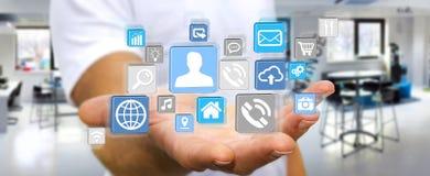Biznesmen używa nowożytnego cyfrowego ikony zastosowanie Fotografia Stock